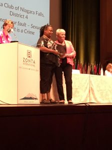 Kathryn accepting the  Award presented by president Sonja Honig Schough on behalf of her club.